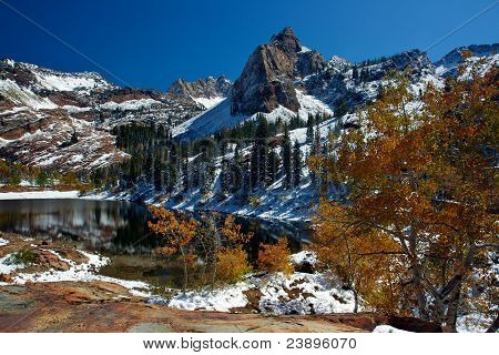 Snowy Alpine lake in Autumn