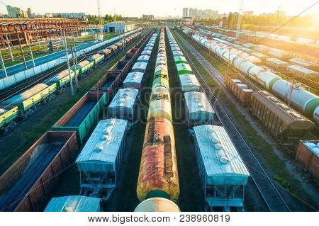 Aerial View Of Colorful Freight Trains On Railroad