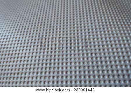 Closeup Of White Material With Embossed Polka Dots