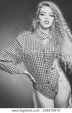 Attractive Radiant Looking Blond Young Woman With Long Wavy Hair Wearing Shirt With Hounds Tooth Pri