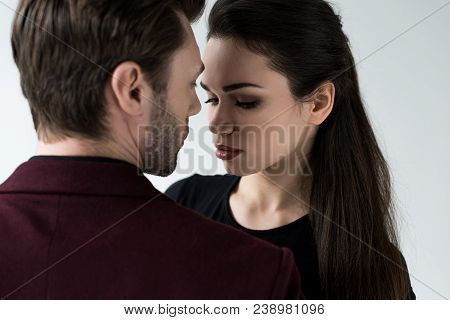 Attractive Sensual Couple Looking At Each Other, Isolated On Grey