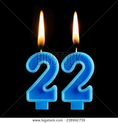 Burning Birthday Candles In The Form Of 22 Twenty Two For Cake Isolated On Black Background. The Con