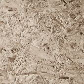 Chipboard, OSB -Oriented strand board particle pressed recycled wood panel background with grainy wooden fiber pattern backdrop in natural beige brown color poster