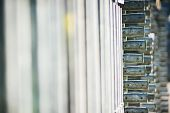 metal structures in a warehouse in stacks. metal supports for scaffolding and formwork. soft focus and bokeh.Outdoors storage of building materials and metal structures. poster