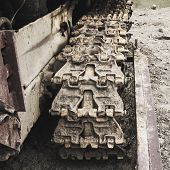 Crawler undercarriage of an old dirty bulldozer poster