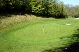 Red Flag And Green Lawn On Golf On Roc De Cheres, In Talloires, Annecy Lake, France