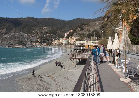 Monterosso, Italy - April 2 2018: The View Of People Walking Along The Sea On Embankment In Monteros