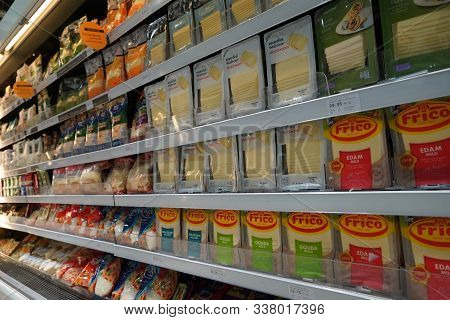 Dubai Uae December 2019 Different Types Of Cheese On Shelves In A Grocery Store. Shelf Of Packaged P