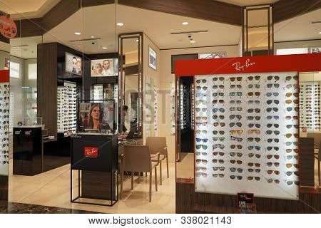 Dubai Uae December 2019 Sunglasses In A Store. Sales Rack Of Sunglasses. Prada, Dior, Roberto Cavall