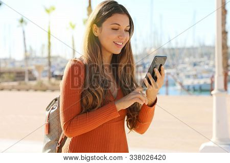 Travel Concept. Beautiful Young Traveler Woman Using Application Map On Smart Phone. Tourist Girl Ex