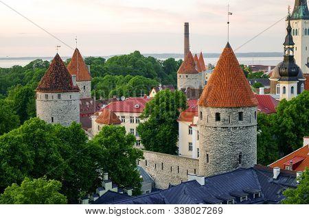 Aerial Cityscape With Medieval Old Town, St. Olaf Baptist Church And Tallinn City Wall, Tallinn, Est