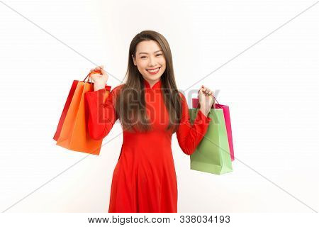 Asian Girl In Vietnamese Ao Dai Dress With Shopping Bag Isolated On White Background.