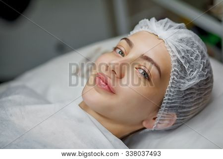 Beauty Portrait Of Female Face With Natural Skin. Beautiful Young Woman With Clean Fresh Skin On Fac