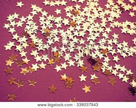 Golden Stars Glitter On Paper Background. Dark Dramatic Backdrop