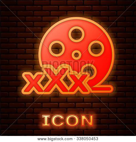Glowing Neon Film Reel With Inscription Xxx Icon Isolated On Brick Wall Background. Age Restriction