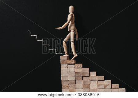 Career growth. Professional ambition. Wooden manikin climbing stairs. Articulated man composition. poster