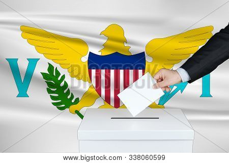 Election In Virgin Islands. The Hand Of Man Putting His Vote In The Ballot Box. Waved Virgin Islands