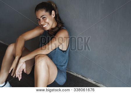 Side Shot Pleased, Happy Laughing Attractive Sportswoman In Fitness Activewear, Sit Floor, Lean Gym