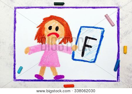 School Grades. Sad Student With Exam Or Test Result. Girl Holding Report Card With F Grade. Photo Of