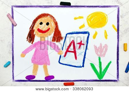 School Grades. Happy Student With Exam Or Test Result.girl Holding Report Card With A+ Grade.  Photo