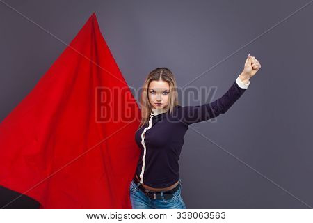 Young Woman With A Red Flag, A Revolutionary Activist, A Fighter For Rights. Portrait Of A Determine