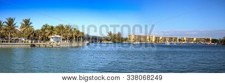 Loxahatchee River With The Jupiter Inlet Lighthouse In The Background Along With Boats In Jupiter, F