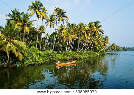 Alappad, Kerala, India - 17 November 2017: Indian Local Man In A Canoe On River In Along The Kollam