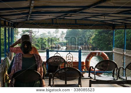 Chavara, Kerala, India - 17 November 2017: Indian Tourists Waiting For A Boat Bridge On Deck Of The