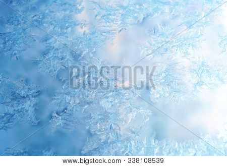 Winter Ice Frost, Frozen Background. Frosted Window Glass Texture. Christmas Fresh, New Year Backgro