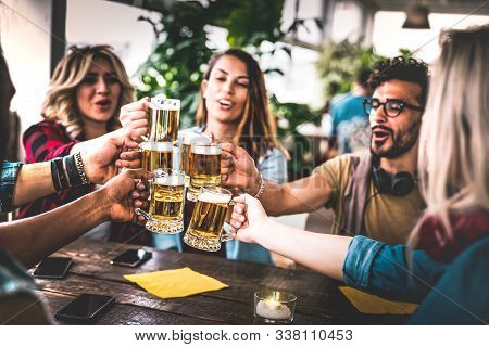 Friends Toasting Beer At Brewery Bar Indoor At Rooftop Party - Friendship Concept With Young People