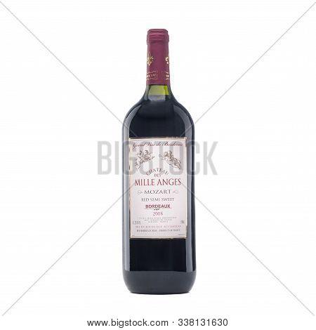 Bottle Of Italian Wine On White Background. Full White Wine Bottle. Isolated On A White Background.