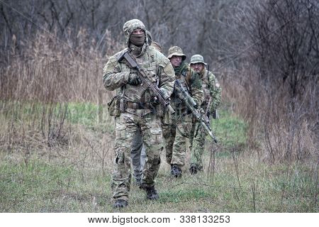 Army Commandos Tactical Group On March In Woods