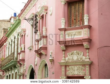 Neoclassical balcony with decoration in white and pink in Old Havana in Cuba