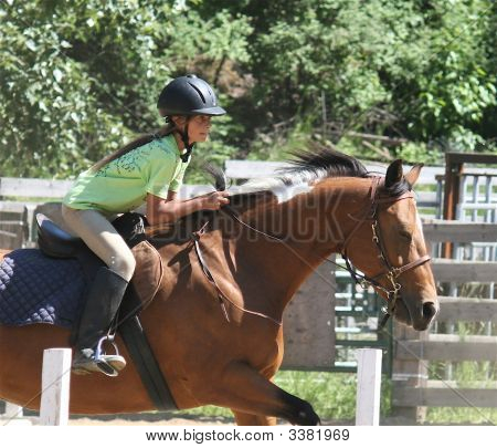girl jumping her horse during an Engish riding equestrian event poster