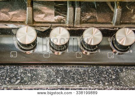 Very Dirty Gas Cooking Hob. The Dirty And Grimy Top Of Gas Cooker Hob Background.