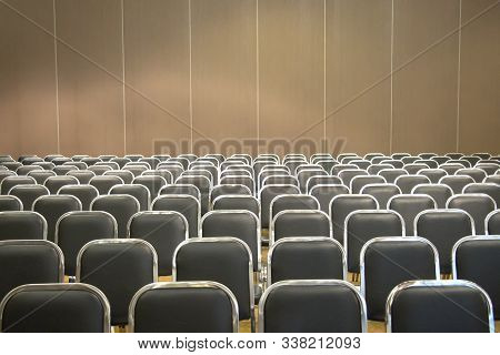 Black Empty Seats In The Audience Prepared For The Participants Of The Conference Or Presentation. O