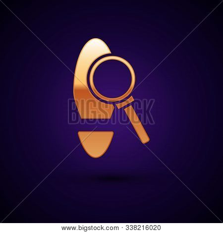 Gold Magnifying Glass With Footsteps Icon Isolated On Dark Blue Background. Detective Is Investigati