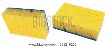 Macro Shot Of A Surface Of Plastic Yellow Sponge Isolated On White Background. Close-up Texture. Yel