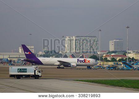 Saigon, Vietnam - May 22, 2019. N106fe Federal Express (fedex) Boeing 767-300er Docking At Tan Son N