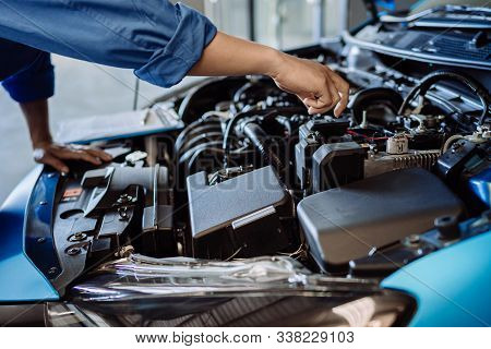 Mechanic Man Examining And Maintenance To Customer The Engine A Vehicle Car Hood, Safety Inspection