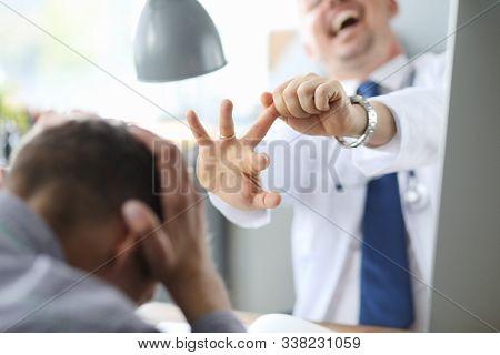 Crazy Doctor Flicked Unfortunate Patient. The Patient Clutched His Head In Horror.