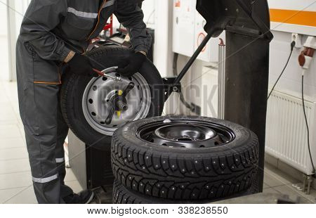 Tire Service.balancing The Wheels Of The Car In The Workshop.