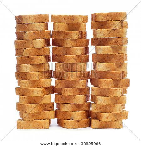 some piles of mini toasts on a white background poster
