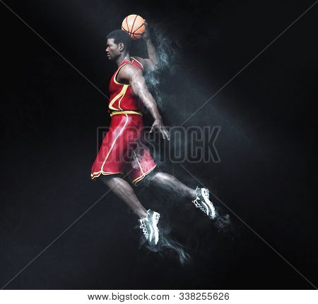 Basketball Player Going In For A Slam Dunk With Smoke And Light Ray Effects. 3d Rendering