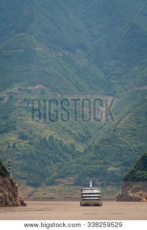 Luxury Passenger Cruise Ship Sailing Through The Gorge On The Magnificent Yangtze River, China