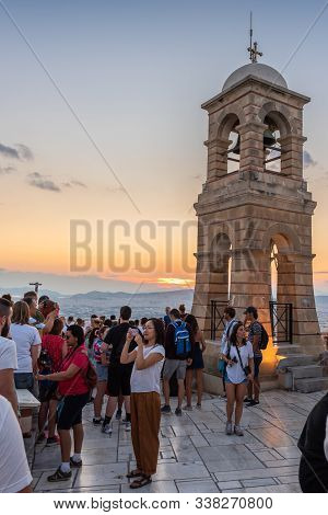 Athens, Greece - September 13, 2018: Tower At The Top Of The Lycabettus Hill With Tourists.