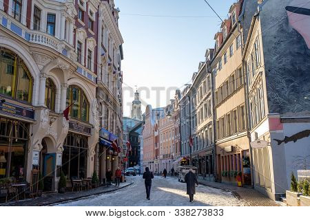 Riga / Latvia - 03 December 2019:riga Old Town Street With Medieval Buildings In Winter Day. Narrow