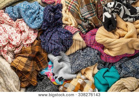 A Bunch Of Different Clothes. Recyclable Textile Background. Sorting At Recycling Clothes