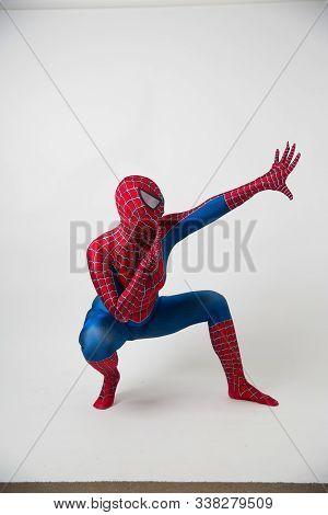December 1, 2019. Israel, Tel Aviv. Spiderman Posing On A White Background, The Animator Dressed As