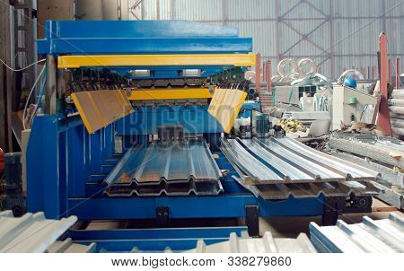 The Industrial Device For Corrugated Metal Sheets Bending By High Precision Machine In Factory. Blue